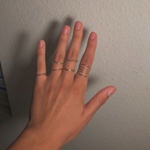 6 rings from forever 21 ! I'm not sure the size